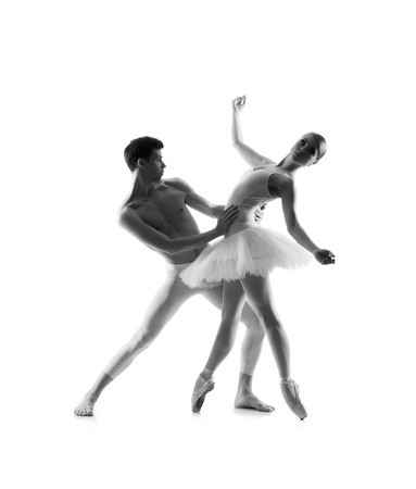 pas: Couple of ballet dancers isolated on white. Black and white