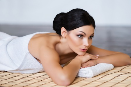 healer: Beautiful, young and healthy woman in spa salon. Spa, health and healing concept.