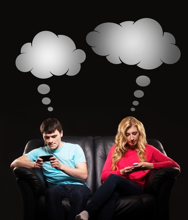 Young man and woman more interested in playing mobile games rather than socialising. Comics concept.