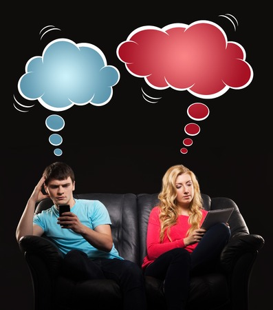 Young couple having disinterest being absorbed by tablet and smartphone. Comics concept. Stock Photo