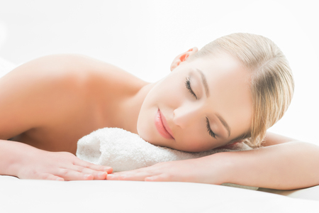 slumber: Beautiful girl sleeping and have a spa treatment isolated on white. Stock Photo