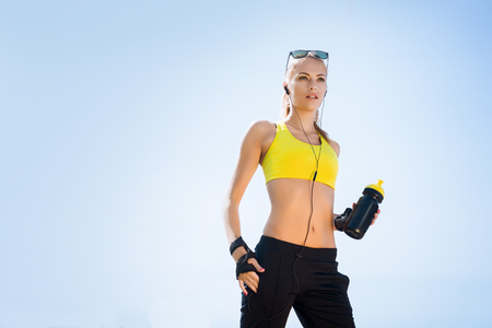 Young, beautiful, sporty and fit girl rollerblading on inline skates Stock Photo