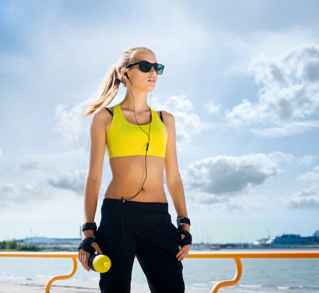 Fit, sporty and athletic young woman. Beautiful girl in a sportswear. Stock Photo