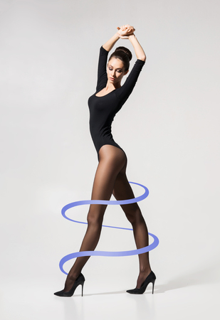 hosiery: Fit and seductive girl in pantyhose. Woman with perfect body. Weight loss, fitness, sport and diet concept.