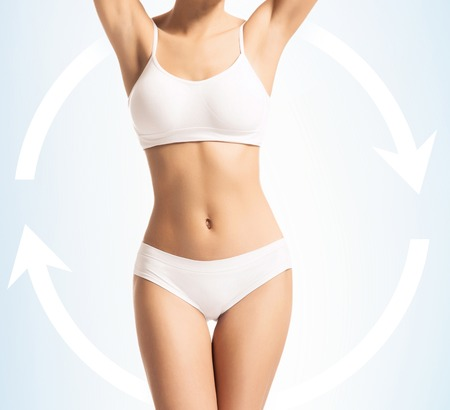 Women slim body in swimwear. Healthy eating, dieting, nutrition, sport and fitness concept with arrows. Stockfoto