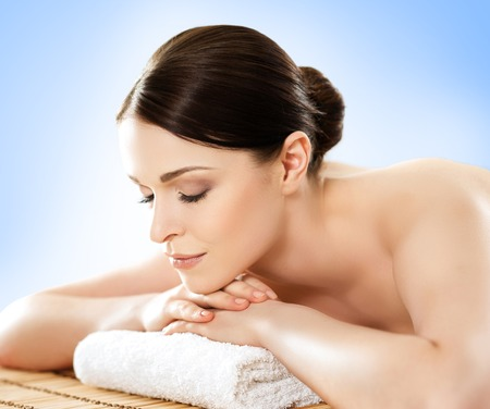 healer: Beautiful, young and healthy woman in spa salon. Massage treatment, traditional medicine and healing concept.