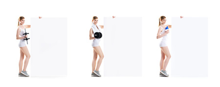Beautiful hot young sporty woman with dumbbell standing nearby the billboard. Set collection.
