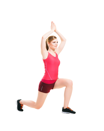 lose up: Fit, healthy and sporty woman in sportswear making physical exercises isolated on white. Stock Photo