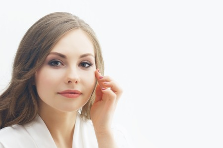 Beauty portrait of young and attractive girl. Make-up and cosmetics concept.