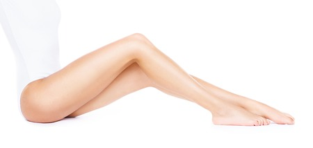Close-up of beautiful, fit and sporty legs isolated on white. Health, sport, fitness, epilation, cellulite and hair removal, liposuction, healthy life-style.