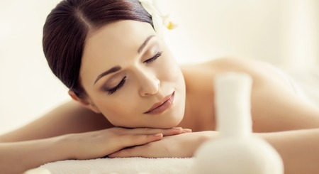 Young and beautiful woman in spa