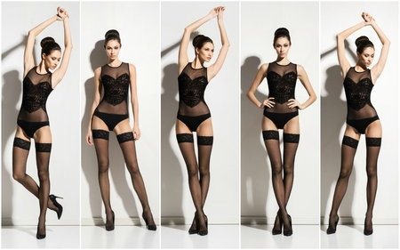 Sexy young woman posing in hosiery and erotic underwear in studio.