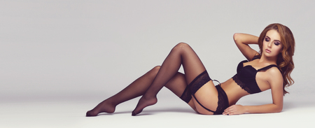 Attractive young woman posing in erotic lingerie. Sexy fashion model in beautiful underwear.