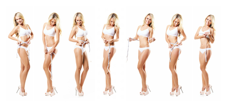 Young, sporty and fit girl in white swimsuit Foto de archivo
