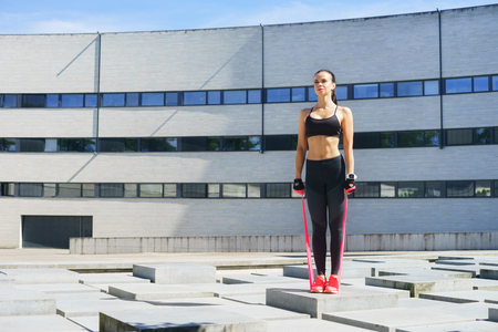 Fitness, sport, urban jogging and healthy lifestyle concept. Young woman training outdoor.