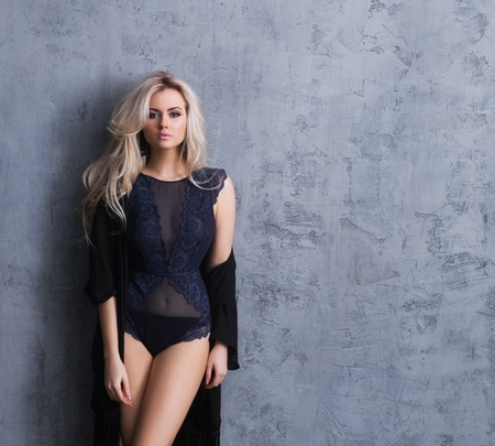 Young, and beautiful blond woman posing in lingerie.