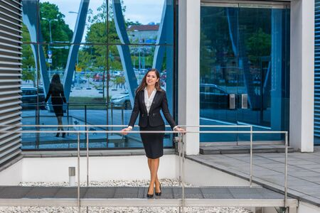 Confident businesswoman in front of modern office building. Business, banking, corporation and financial market concept. Stok Fotoğraf - 130648126