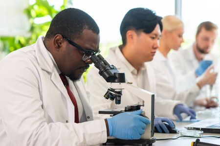 Scientist and students working in lab. Doctor teaching interns to make analyzing research. Biotechnology, chemistry, bacteriology, virology, dna and health care concept. Stok Fotoğraf - 133670104