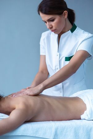 Young woman in spa. Traditional healing therapy and massaging treatments. Health, skin care, massage, osteopathy and recreation.