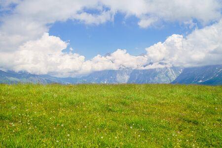 Alpine peaks landskape background. Jungfrau, Bernese highland. Alps, tourism, journey, hiking concept.