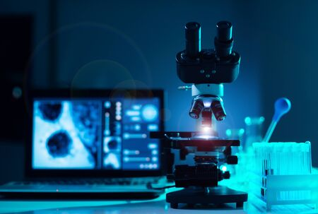 Close-up of scientific microscope. Laboratory in hospital. Epidemic disease, healthcare, vaccine research and coronavirus 2019-ncov test.