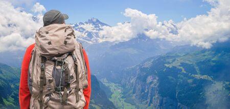 Traveler with backpack. Alpine peaks landskape background. Lauterbrunnen, Jungfrau, Bernese highland. Alps, tourism journey hiking concept