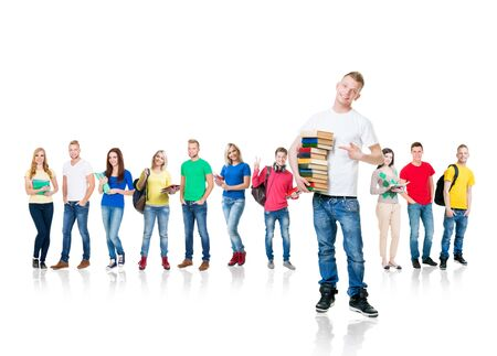 Large group of teenage students isolated on white background. Many different people standing together. School, education, college, university. Stockfoto