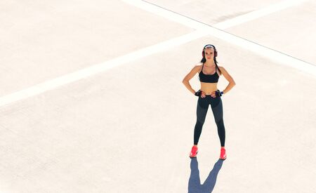 Young, fit and sporty woman doing exercises outdoor. Fitness, sport and healthy lifestyle.