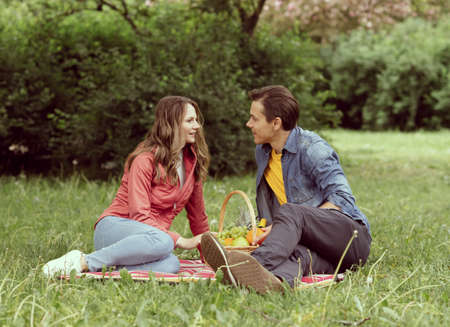 Young, happy, loving couple having date in the park. Relations, friendship and love.