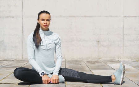 Young and sporty brunette woman training outdoor. Fitness, sport, lifestyle and health care. Stockfoto