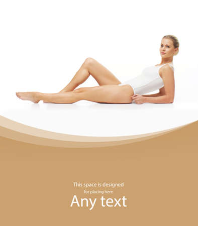 Young, beautiful, slim and healthy blond girl in white swimsuit. Massage, skincare, healthcare, wrinkles removal and fitness concept. Stockfoto