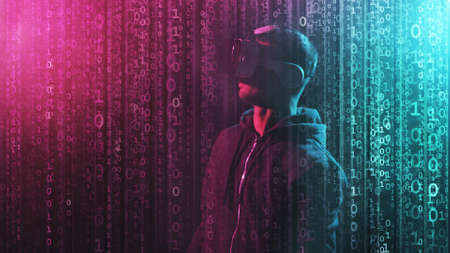Portrait of a man in virtual reality helmet over abstract digital background. Obscured dark face in VR goggles. Internet, darknet, gaming and cyber simulation concept. Stock Photo