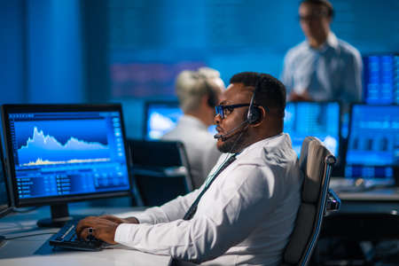 Team of brokers is working in office using workstation and analysis technology. Workplace of professional traders. Global financial markets, business, currency exchange and banking concepts. Stock fotó