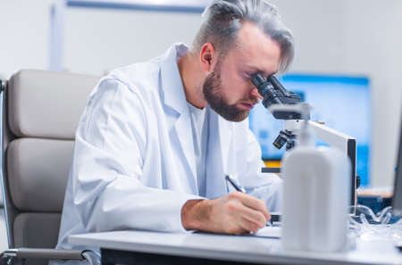 Professional scientist is working on a vaccine in a modern scientific research laboratory. Genetic engineer workplace. Future technology and science.