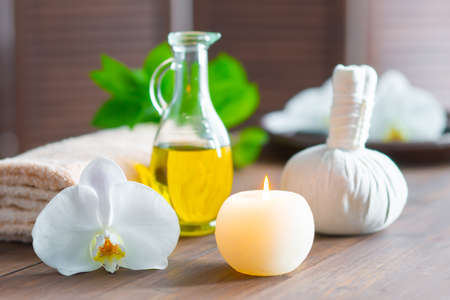 Spa background. Towel, candles, orchid flowers and herbal balls. Massage, oriental therapy, wellbeing and meditation.