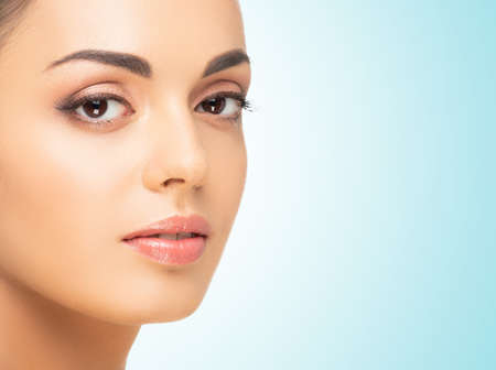 Beautiful face of young and healthy woman. Spa, cosmetology and healthcare.