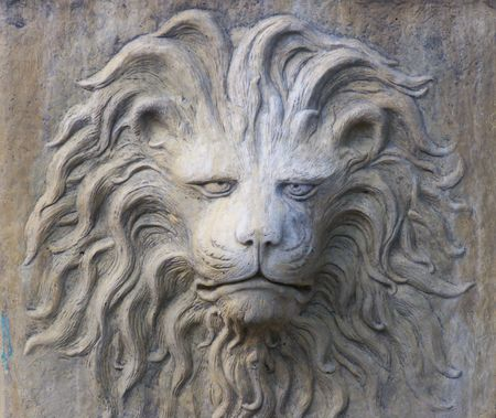 planter: Stone Lion Face of planter on street in Savannah, GA