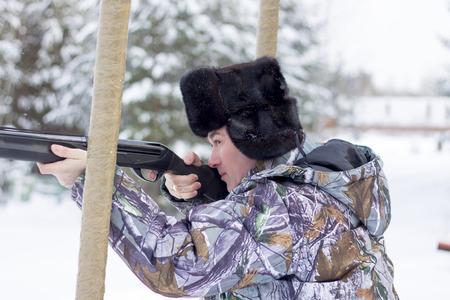 cap hunting dog: Russian hunter in winter