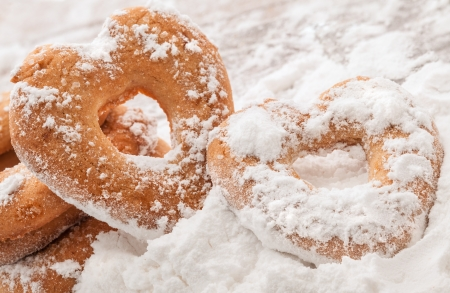 Two heart shaped cookies covered with powdered sugar Stock Photo - 14648716