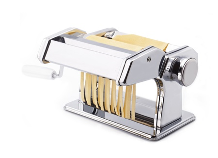 machine: Pasta machine with fresh noodles, Homemade Pasta, isolated on white background Stock Photo