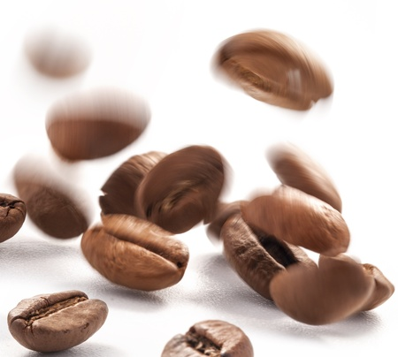 coffe bean: Flying coffee beans on a white background, close-up