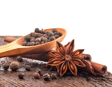 muscat: Different spices, Cinnamon, anise on wooden old table, on white background