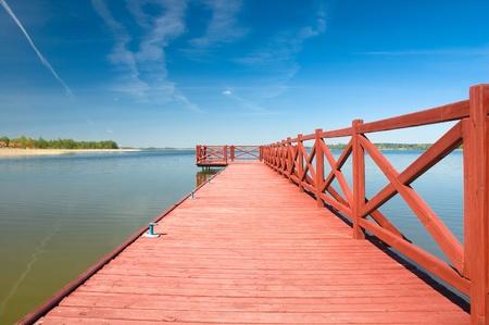 masuria: Footbridge on the lake in Masuria district, Poland