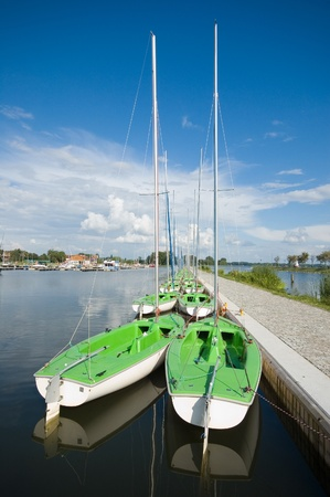 Sailboats moored in marina, Masuria, Poland photo