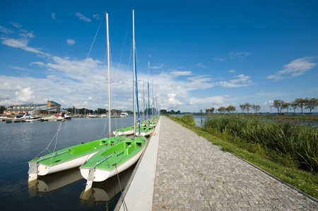 Sailing boats moored in port, Masuria, Poland photo