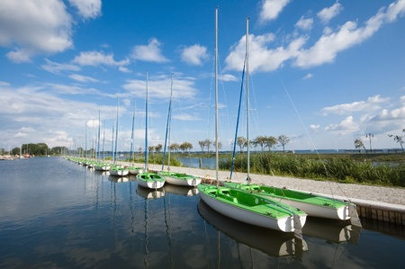 Sailing boats moored in marina, Masuria, Poland photo