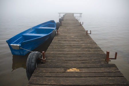 Boat on a fog covered lake Stock Photo - 12835539