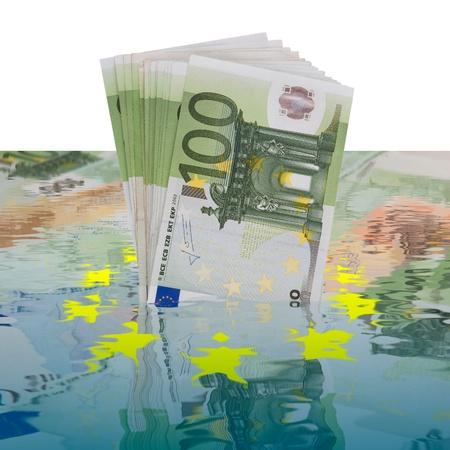 100 euros banknotes sinking in water Stock Photo