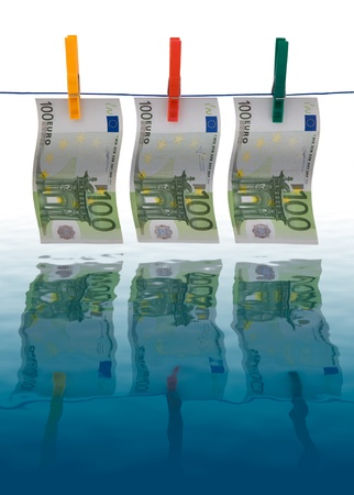 money laundering: Picture showing money laundering concept - 100 euros banknotes drying on a clothes line Stock Photo