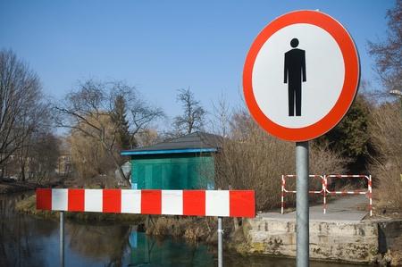 Road closed - no pedestrians sign photo